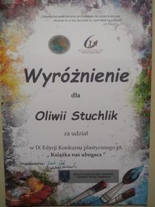 """Dyplom wyróżnienia dla uczennicy w konkursie """"Książka nas ubogaca"""""""